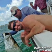 Jeremy Bennett and his first tarpon with Capt Pete Rapps